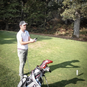 Player with golf gps app on the course